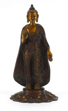Chino-Tibetan bronzed figure of a standing deity, 28.5cm high :For Further Condition Reports