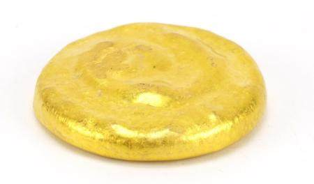 Chinese gold coloured metal scroll weight, impressed character marks, 6cm in diameter :For Further