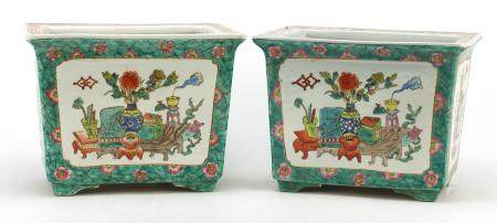 Pair of Chinese porcelain planters, each hand painted in the famille rose palette with panels of