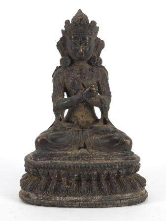 Chino-Tibetan patinated bronze figure of seated Buddha, 19cm high :For Further Condition Reports