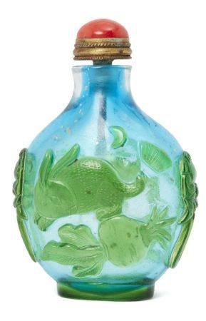 A Chinese Peking glass cameo snuff bottle, late Qing dynasty, carved in green over blue with a