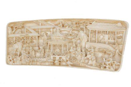 A Chinese ivory wrist rest, late 19th/early 20th century, pierced and decorated with a scene of