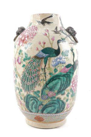 A Chinese porcelain vase, 20th century, with moulded mask and ring handles, decorated with peacock