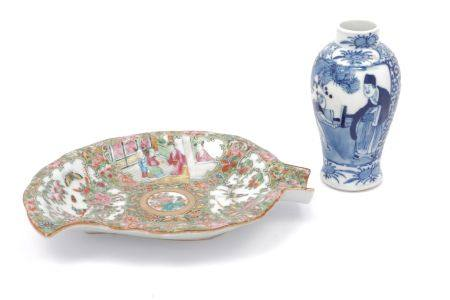 A Chinese Cantonese porcelain leaf shaped dish, late 19th century, decorated with four panels of