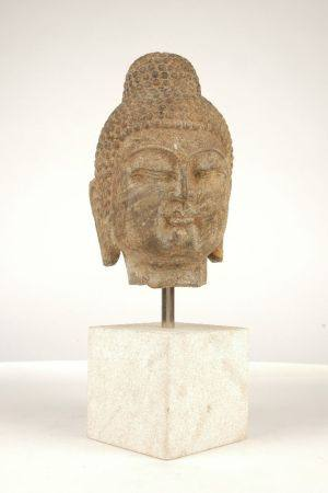 A Song dynasty style carved stone head of Buddha, 20th century, mounted on a square stone block, the