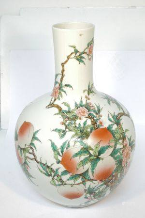 A large Chinese porcelain bottle vase, off recent manufacture, decorated with peach in branches,