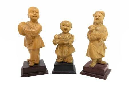 Chinese wooden sculpture of three children, with stand, China, eighteenth century. H 8 cm; 9; 11.