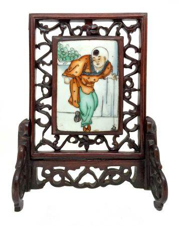 Chinese porcelain plaque depicting children, China, eighteenth century. Set in a carved wooden