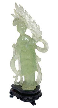 Chinese statuette in jade, light green, depicting Guanine. Beijing. Early 1900s. H 20. H cm with