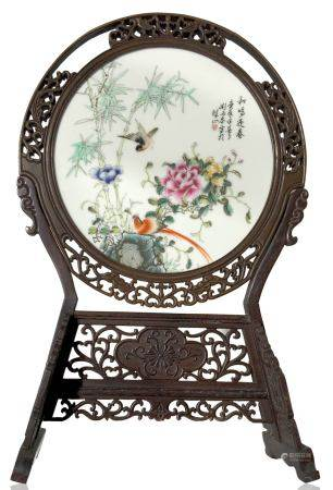 Circular chinese porcelain plate depicting bamboo, birds, and peony flower, a symbol of good luck