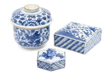 Two Chinese porcelain boxes and a bowl and cover, 17th-19th century, each painted in underglaze blue