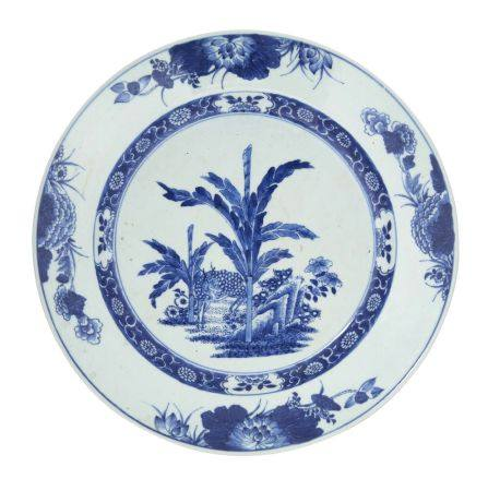 A Chinese export porcelain dish, 18th century, painted in underglaze blue with a deer amongst bamboo