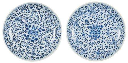 A pair of Chinese porcelain 'peony' dishes, Kangxi period, painted in underglaze blue with flowering