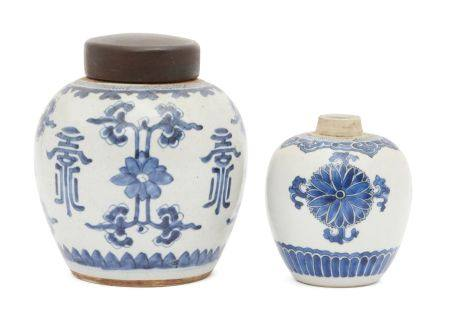 Two Chinese porcelain jars, 18th century, painted in underglaze blue with stylised floral sprays,