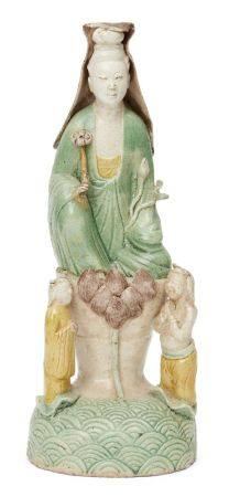 A Chinese biscuit porcelain sancai Guanyin figure group, Kangxi period, modelled as Guanyin seated