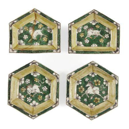Four Chinese biscuit porcelain sancai hors d'oeurves dishes, Kangxi period, each painted with a