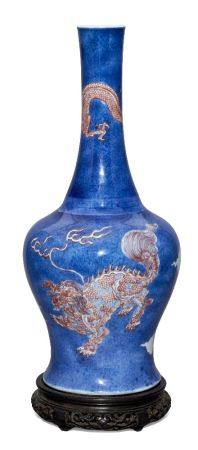 A rare Chinese porcelain powder blue ground bottle vase, Kangxi period, painted in underglaze blue