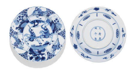 A pair of blue and white 'hunting' foliate-rimmed dishes Kangxi six-character marks and of the period (2)