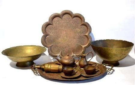 An Indonesian Betel Lime Grinder, & Eight Brass Alloy Bowls,