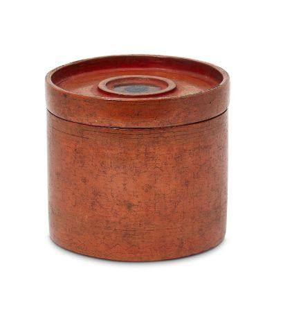 A Burmese red lacquer cylindrical box and cover, 19th century, decorated with stylised floral