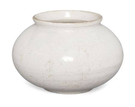 A Korean jar, Joseon dynasty, 19th century, of compressed globular form and everted rim with allover