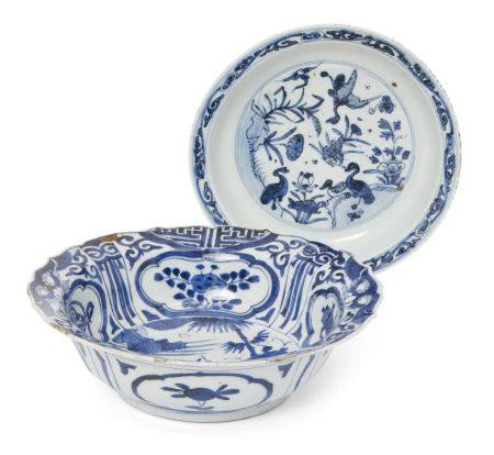 A Japanese Arita porcelain bowl and dish, 17th century, the bowl painted in underglaze blue with a