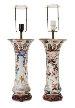 A pair of Japanese Imari porcelain vases, early 19th century, painted with birds amongst foliage,