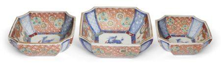 A set of three Japanese porcelain graduated square bowls, Meiji period, painted in the Imari palette