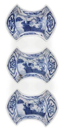 Three Japanese porcelain ingot shaped dishes, Meiji period, painted in underglaze blue with