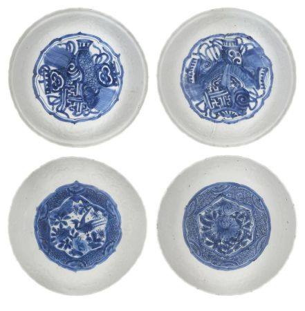 A pair of Japanese porcelain dishes, late 17th century, painted in underglaze blue to the central