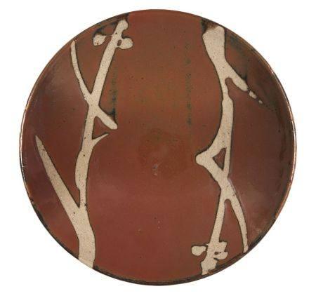 Shoji Hamada, Japanese 1894-1978, a stoneware dish with tenmoku glaze, diameter 27.5cm Provenance: