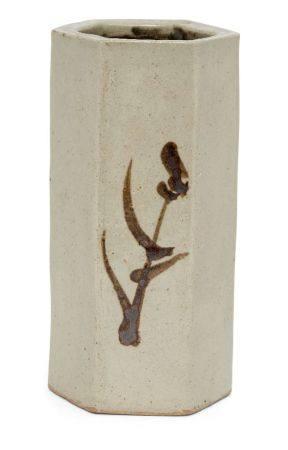 Shoji Hamada, Japanese 1894-1978, a stoneware hexagonal vase painted in tenmoku with typical
