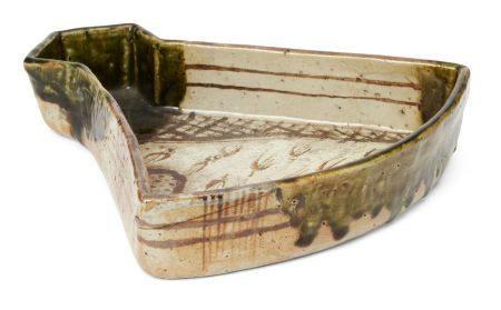 Kitaoji Rosanjin, Japanese 1883-1959, Oribe-ware fan shaped dish, c.1950s, green glazed stoneware