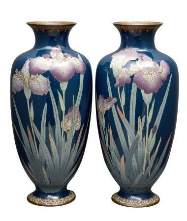 A pair of large Japanese cloisonné baluster vases, Meiji period, decorated with irises on a blue