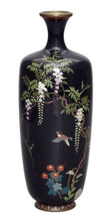 A Japanese cloisonné enamel vase, Meiji period, finely decorated with sparrow beneath wisteria,