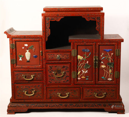 A RARE AND UNUSUAL CHINESE RED LACQUER CABINET WITH GEM STONE INLAID