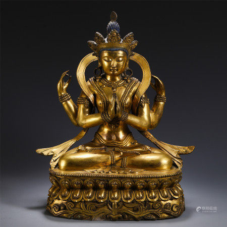 CHINESE GILT BRONZE FOUR ARM SEATED GUANYIN WITH LOTUS
