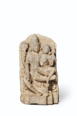 A WHITE MARBLE RELIEF OF UMA MAHESHVARA WESTERN INDIA, RAJASTHAN OR GUJARAT, 12TH-13TH CENTURY