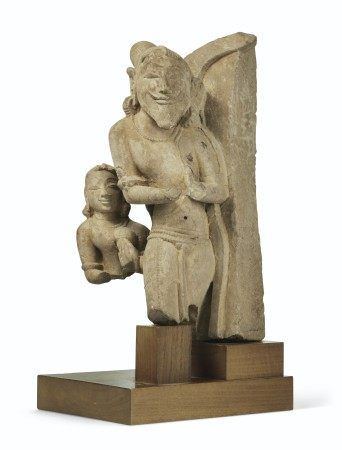 A BUFF SANDSTONE FIGURAL RELIEF OF ATTENDANTS CENTRAL INDIA, 10TH-11TH CENTURY