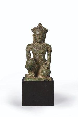 A RARE BRONZE FIGURE OF VISHVAKARMA KHMER, ANGKOR WAT STYLE, 12TH CENTURY
