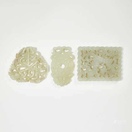 A Group of Three Celadon White Jade Reticulated Plaque,