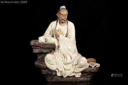 SHIWAN WARE 'LU YU' SEATED FIGURE