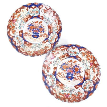 A pair of Chinese porcelain chargers, hand painted blue and red floral decoration, diameter 40cm