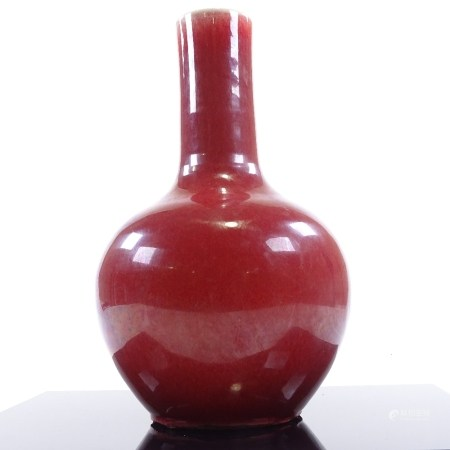 A Chinese sang de boeuf glaze narrow-neck vase, height 34cm A number of chips on the underside of