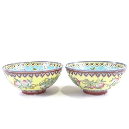 A pair of Chinese porcelain bowls, with painted enamel fruit designs and text, diameter 12cm Perfect