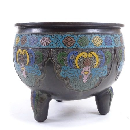 A Chinese bronze and champleve enamel jardiniere on 3 feet, diameter 27cm, height 23cm