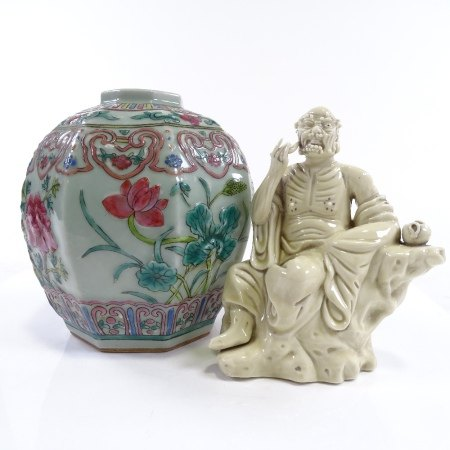 A Chinese porcelain jar with moulded and painted decoration, height 17cm, and a Chinese white