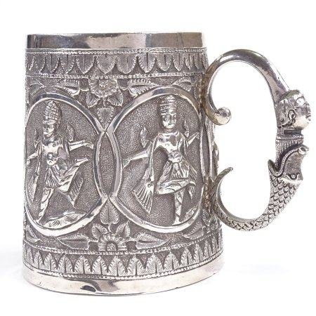 An early 20th century Indian Madras unmarked white metal half pint mug, tapered cylindrical form