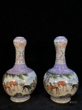 PAIR OF CHINESE PORCELAIN FAMILLE ROSE DOG VASES
