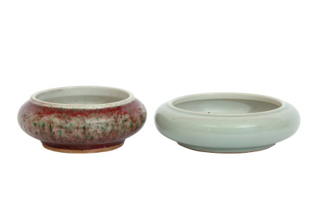 Two Chinese porcelain brush washer pots, one with green celadon type glaze and Qianlong mark to